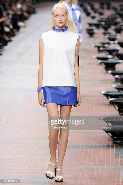 A model walks the runway at the Kenzo Spring Summer 2014 fashion show during Paris Fashion Week on September 29 2013 in Paris France