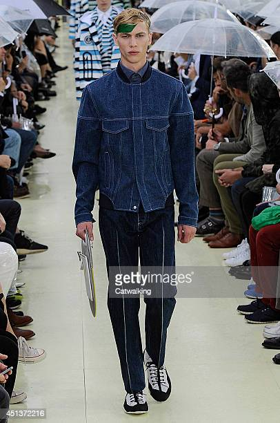 Model walks the runway at the Kenzo Spring Summer 2015 fashion show during Paris Menswear Fashion Week on June 28, 2014 in Paris, France.