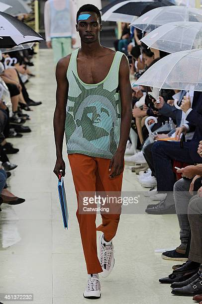 A model walks the runway at the Kenzo Spring Summer 2015 fashion show during Paris Menswear Fashion Week on June 28 2014 in Paris France
