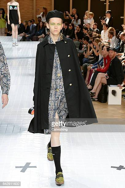 A model walks the runway at the Kenzo Spring Summer 2017 fashion show during Paris Menswear Fashion Week on June 25 2016 in Paris France