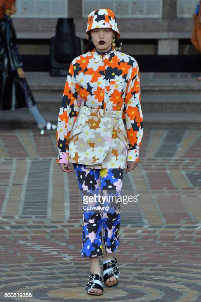 A model walks the runway at the Kenzo Spring Summer 2018 fashion show during Paris Menswear Fashion Week on June 25 2017 in Paris France
