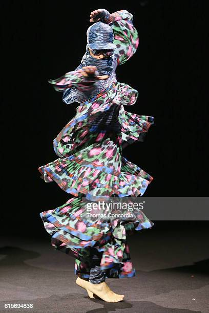 Model walks the runway at the KENZO x H&M Launch Event Directed By Jean-Paul Goude' at Pier 36 on October 19, 2016 in New York City.