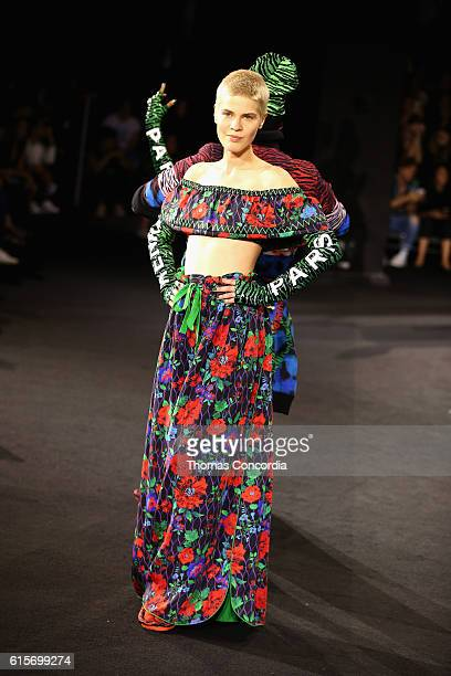 A model walks the runway at the KENZO x HM Launch Event Directed By JeanPaul Goude' at Pier 36 on October 19 2016 in New York City