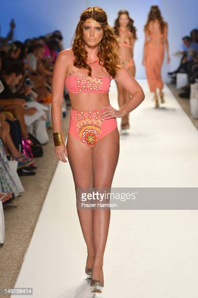 Model walks the runway at the Keva J show during Mercedes-Benz Fashion Week Swim 2013 at The Raleigh on July 23, 2012 in Miami Beach, Florida.