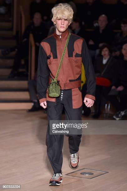 A model walks the runway at the Kiko Kostadinov Autumn Winter 2018 fashion show during London Menswear Fashion Week on January 7 2018 in London...