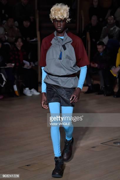 A model walks the runway at the Kiko Kostadinov Fall/Winter 2018/2019 show during London Fashion Week Men's January 2018 at Old Selfridges Hotel on...