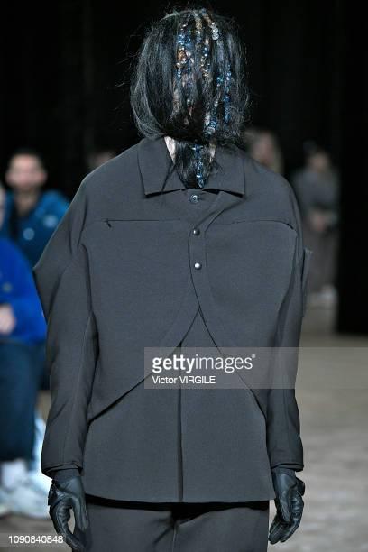 A model walks the runway at the Kiko Kostadinov Fall/Winter 20192020 fashion show during London Fashion Week Men's January 2019 on January 6 2019 in...