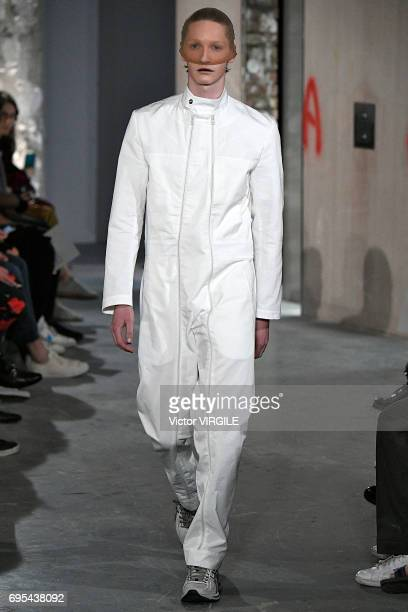 A model walks the runway at the Kiko Kostadinov fashion show during the London Fashion Week Men's June 2017 Spring Summer 2018 collections on June 11...