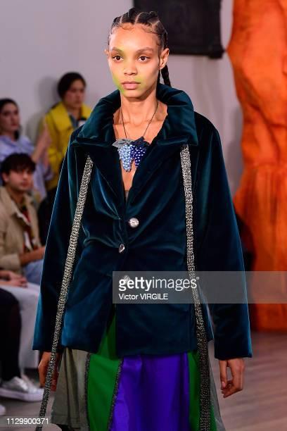 Model walks the runway at the Kiko Kostadinov Ready to Wear Fall/Winter 2019-2020 fashion show during London Fashion Week February 2019 on February...