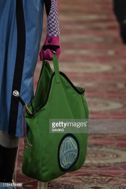 Model walks the runway at the Kiko Kostadinov Ready to Wear Spring/Summer 2020 fashion show during London Fashion Week Men's June 2019 on June 07,...