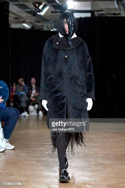 A model walks the runway at the KIKO KOSTADINOV show during London Fashion Week Men's January 2019 on January 6 2019 in London England