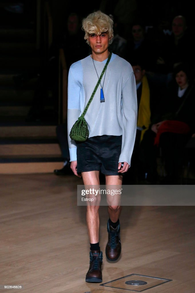 A model walks the runway at the Kiko Kostadinov show during London Fashion Week Men's January 2018 at Friends House on January 7, 2018 in London, England.
