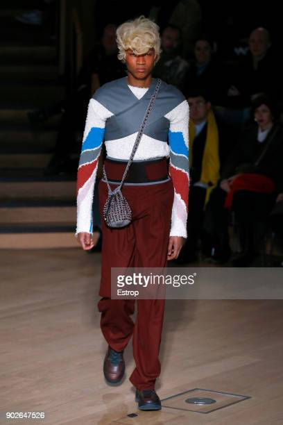 A model walks the runway at the Kiko Kostadinov show during London Fashion Week Men's January 2018 at Friends House on January 7 2018 in London...