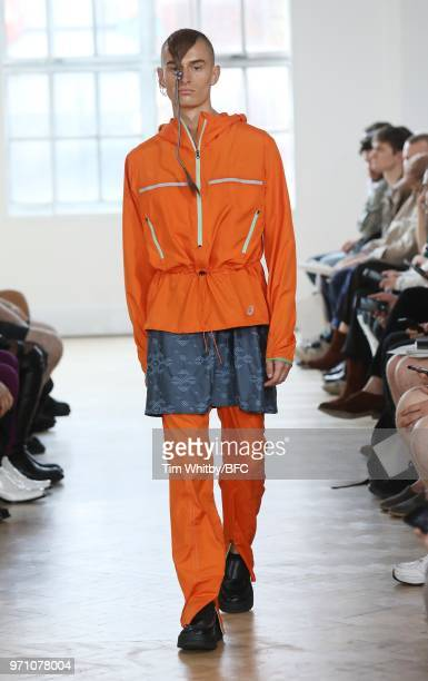 A model walks the runway at the Kiko Kostadinov show during London Fashion Week Men's June 2018 at The China Exchange on June 10 2018 in London...