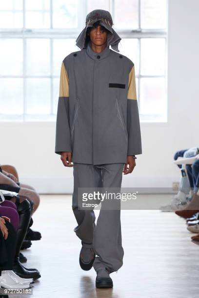 A model walks the runway at the Kiko Kostadinov show during London Fashion Week Men's June 2018 The China Exchange on June 10 2018 in London England