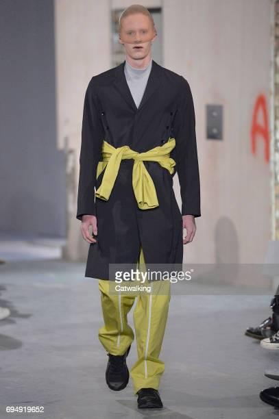 A model walks the runway at the Kiko Kostadinov Show Spring Summer 2018 fashion show during London Menswear Fashion Week on June 11 2017 in London...