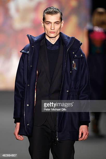 A model walks the runway at the Kilian Kerner show during MercedesBenz Fashion Week Autumn/Winter 2014/15 at Brandenburg Gate on January 14 2014 in...