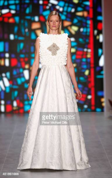 A model walks the runway at the Kilian Kerner show during the MercedesBenz Fashion Week Spring/Summer 2015 at Erika Hess Eisstadion on July 8 2014 in...