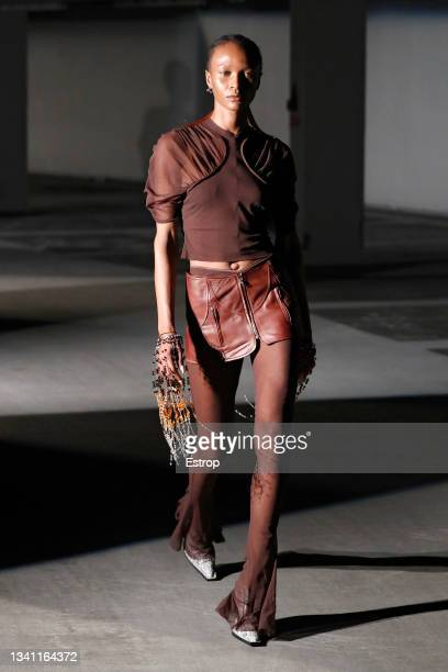 Model walks the runway at the KNWLS show during London Fashion Week September 2021 at Q Park Level 3 on September 18, 2021 in London, England.