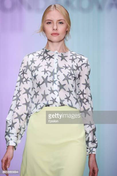 Model walks the runway at the KONDAKOVA fashion show during day four of Mercedes Benz Fashion Week Russia S/S 2018 at Manege on October 24, 2017 in...