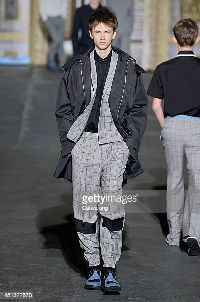 A model walks the runway at the Kris Van Assche Spring Summer 2015 fashion show during Paris Menswear Fashion Week on June 27 2014 in Paris France