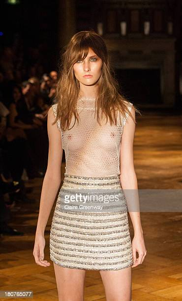 A model walks the runway at the Kristian Aadnevik show during London Fashion Week SS14 at The Royal Horseguards on September 15 2013 in London England