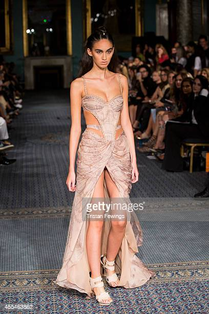 A model walks the runway at the Kristian Aadnevik show during London Fashion Week Spring Summer 2015 on September 14 2014 in London England