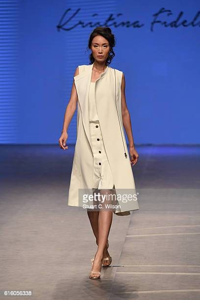 A model walks the runway at the Kristina Fidelskaya show during Fashion Forward Spring/Summer 2017 at the Dubai Design District on October 21 2016 in...