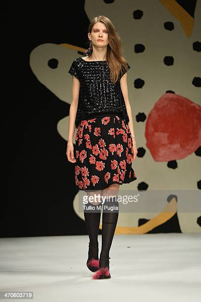 A model walks the runway at the Kristina Ti Show during Milan Fashion Week Womenswear Autumn/Winter 2014 on February 20 2014 in Milan Italy