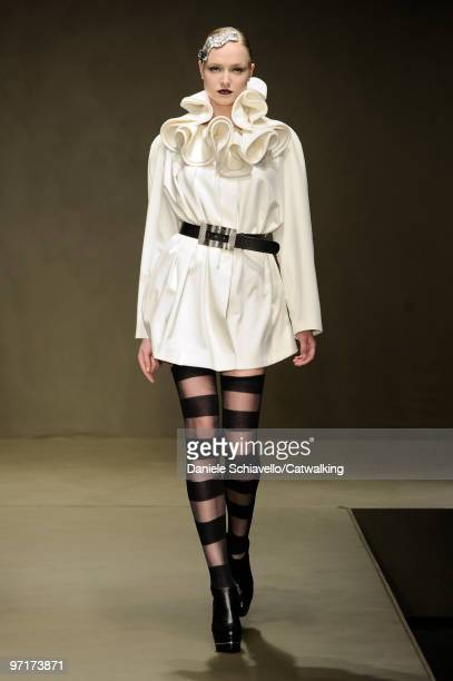 Model walks the runway at the Krizia show during Milan Fashion Week Autumn/Winter 2010 on February 25, 2010 in Milan, Italy .