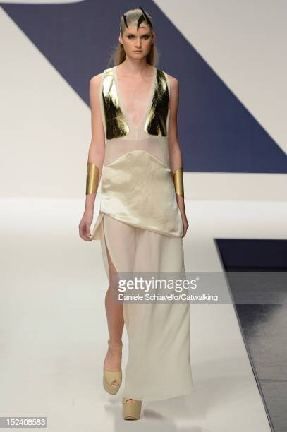 A model walks the runway at the Krizia Spring Summer 2013 fashion show during Milan Fashion Week on September 20 2012 in Milan Italy