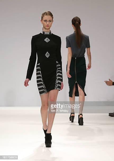 A model walks the runway at the Krystof Strozyna show during London Fashion Week Fall/Winter 2013/14 at Freemasons Hall on February 15 2013 in London...