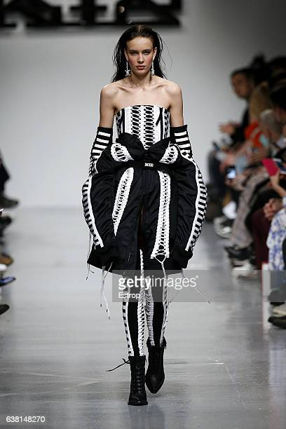 A model walks the runway at the KTZ show during London Fashion Week Men's January 2017 collections at BFC Show Space on January 8 2017 in London...