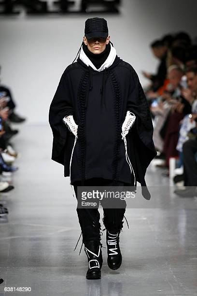 Model walks the runway at the KTZ show during London Fashion Week Men's January 2017 collections at BFC Show Space on January 8, 2017 in London,...