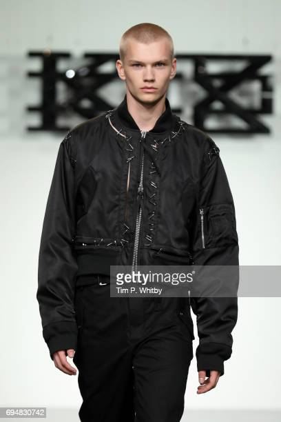 A model walks the runway at the KTZ show during the London Fashion Week Men's June 2017 collections on June 11 2017 in London England