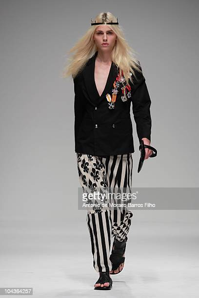 A model walks the runway at the KTZ S/S 2011 show at London Fashion Week at Somerset House on September 22 2010 in London England