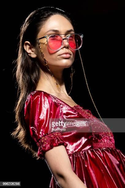 A model walks the runway at the 'La Condesa' catwalk during the MercedesBenz Madrid Fashion Week Spring/Summer in Madrid Spain July 11 2018