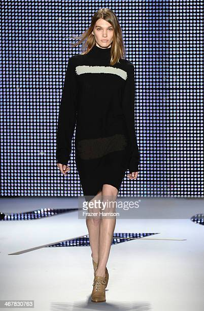 A model walks the runway at the Lacoste fashion show during MercedesBenz Fashion Week Fall 2014 at The Theatre at Lincoln Center on February 8 2014...