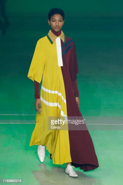 Model walks the runway at the Lacoste show at Paris Fashion Week Autumn/Winter 2019/20 on March 5, 2019 in Tenis Club de Paris, France.