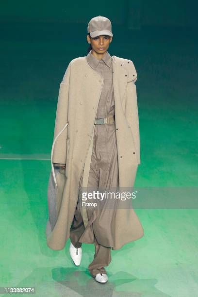 A model walks the runway at the Lacoste show at Paris Fashion Week Autumn/Winter 2019/20 on March 5 2019 in Tenis Club de Paris France