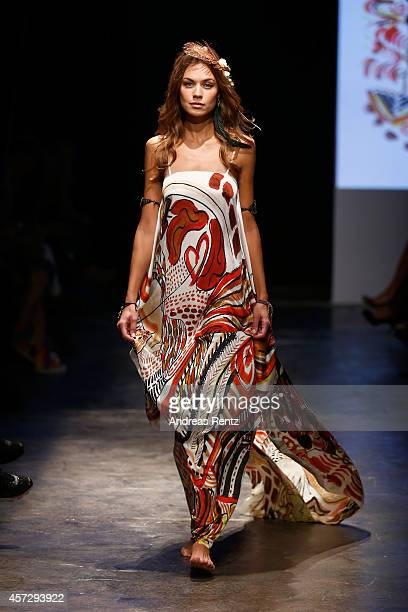 Model walks the runway at the Lady Faith By Nazli Soylu show during Mercedes Benz Fashion Week Istanbul SS15 at Antrepo 3 on October 16, 2014 in...