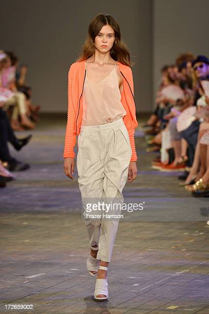 A model walks the runway at the Lala Berlin Show during MercedesBenz Fashion Week Spring/Summer 2014 at Opernwerkstaetten on July 4 2013 in Berli