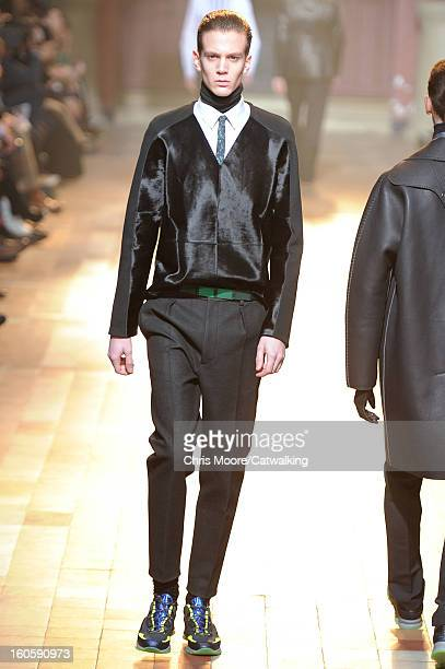 A model walks the runway at the Lanvin Autumn Winter 2013 fashion show during Paris Menswear Fashion Week on January 20 2013 in Paris France