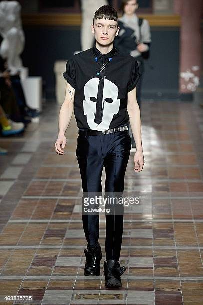 Model walks the runway at the Lanvin Autumn Winter 2014 fashion show during Paris Menswear Fashion Week on January 19, 2014 in Paris, France.