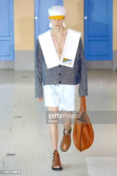 A model walks the runway at the Lanvin show during Paris Men's Fashion Week Spring/Summer 2020 on June 23 2019 in Paris France