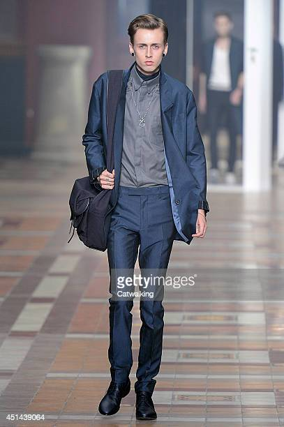 Model walks the runway at the Lanvin Spring Summer 2015 fashion show during Paris Menswear Fashion Week on June 29, 2014 in Paris, France.