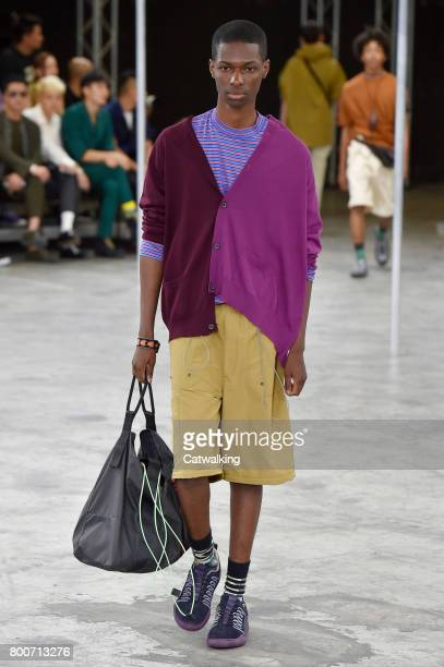 Model walks the runway at the Lanvin Spring Summer 2018 fashion show during Paris Menswear Fashion Week on June 25, 2017 in Paris, France.