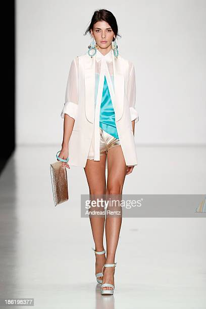 A model walks the runway at the Laroom show during MercedesBenz Fashion Week Russia S/S 2014 on October 29 2013 in Moscow Russia