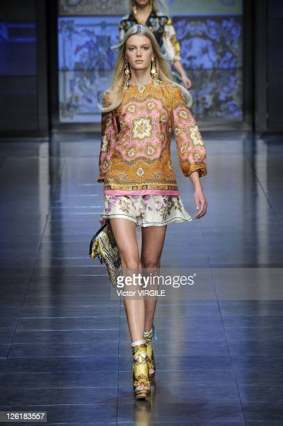 Model walks the runway at the last D&G fashion show as part of Milan Fashion Week Womenswear Spring/Summer 2012 on September 22, 2011 in Milan, Italy.