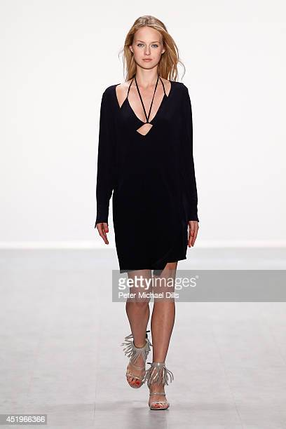 A model walks the runway at the Laurel show during the MercedesBenz Fashion Week Spring/Summer 2015 at Erika Hess Eisstadion on July 10 2014 in...